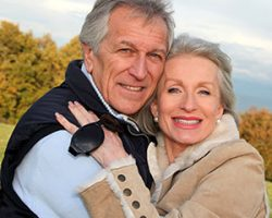 Senior couple smiling with dental implants from Everwell Dentistry.