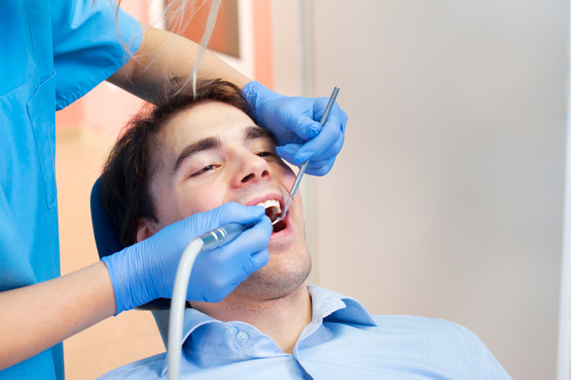 Man receiving a dental cleaning by Ann Arbor Dentist at Everwell Dentistry.